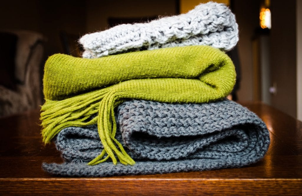 keeping warm clothes in your car can help you in an emergency incident